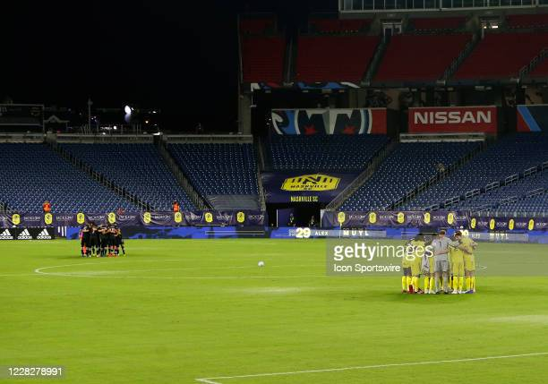 Nashville SC and Inter Miami huddle in front a no fans prior to a match between Nashville SC and Inter Miami CF on August 30 at Nissan Stadium in...