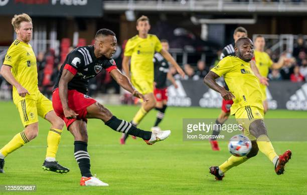 Nashville SC midfielder Brian Anunga moves in to block a shot by D.C. United forward Ola Kamara during an MLS match between D.C. United and Nashville...