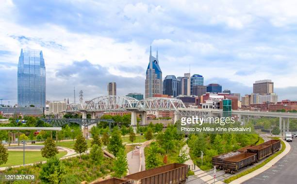 nashville skyline with cumberland park - nashville stock pictures, royalty-free photos & images