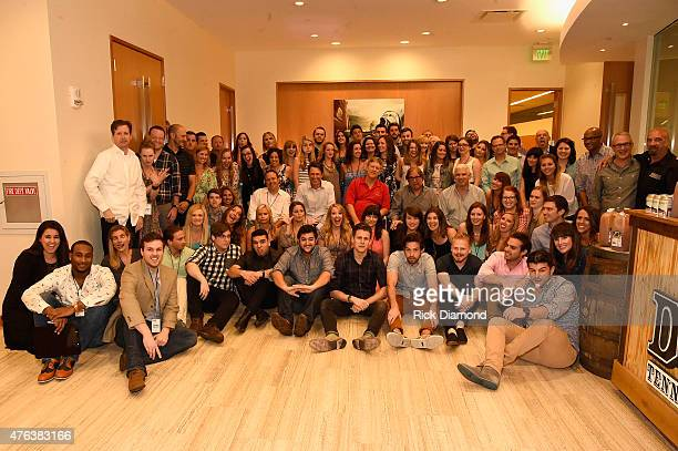 Nashville staff pose for a photo at the 23rd Annual CAA BBQ at Creative Artists Agency's Nashville office on June 8 2015 in Nashville Tennessee