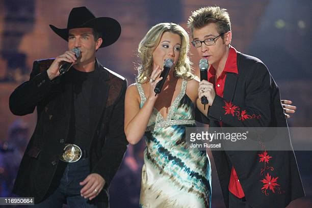 Nashville Star finalist Erika Jo center Jody Evans right and Jason Meadows performs 'Big Star' during the final episode of Nashville Star at the...