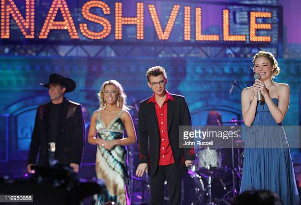 Nashville Star host LeAnn Rimes introduces the three finalists Jason Meadows left Erika Jo and Jody Evans during the final episode of Nashville Star...