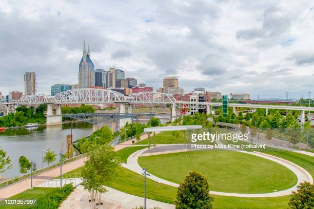 nashville with cumberland park and the cumberland river. - nashville stock pictures, royalty-free photos & images