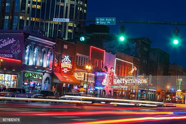 nashville's broadway at night - nashville stock pictures, royalty-free photos & images
