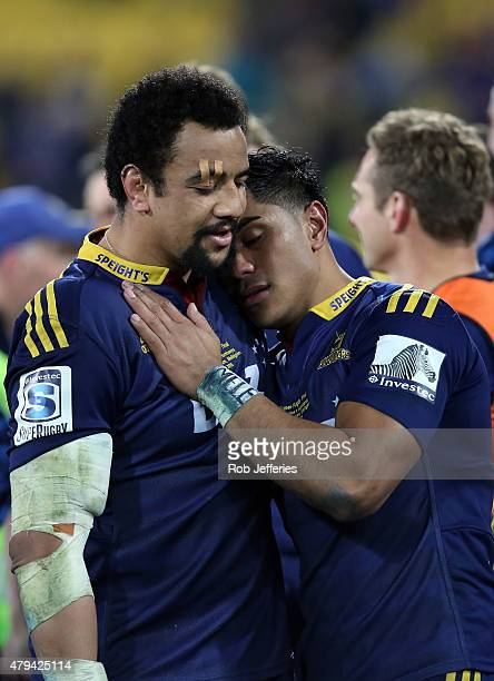 Nasi Manu and Malakai Fekitoa of the Highlanders share a moment after winning the Super Rugby title during the Super Rugby Final match between the...