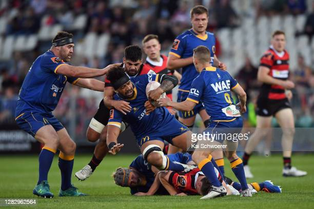 Nasi Manu of Otago is tackled by Billy Harmon of Canterbury during the round 8 Mitre 10 Cup match between Canterbury and Otago at Orangetheory...