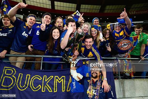 Nasi Manu of the Highlanders holds the trophy up for fans following the Super Rugby Final match between the Hurricanes and the Highlanders at Westpac...