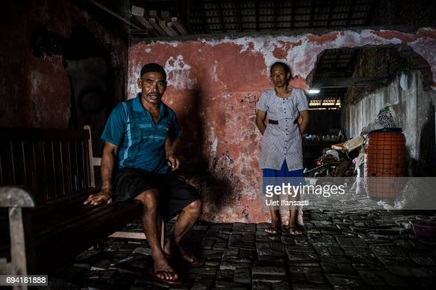 Nasikin and his wife Warsipah inside their house which has been eighteen years living in a house surrounded by rising sea levels at Sriwulan village...