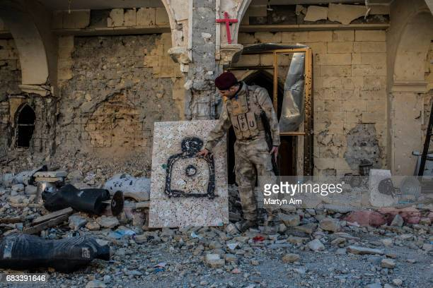 Nasim 22 years old is a member of the Nineveh Plains Protection Unit a Christian fighting unit formed to fight the Islamic State Nasim points out a...