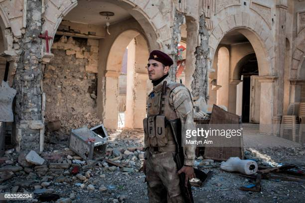 Nasim 22 years old is a member of the Nineveh Plains Protection Unit a Christian fighting unit formed to fight the Islamic State Nasim stands in the...