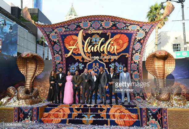 Nasim Pedrad Marwan Kenzari Naomi Scott Mena Massoud Guy Ritchie Alan Menken Will Smith Navid Negahban and Numan Acar attend the premiere of Disney's...
