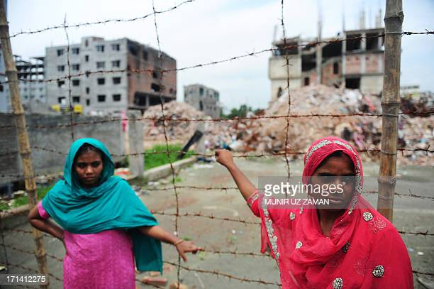 Nasima Akter and another Bangladeshi labourer, that worked inside the collapsed building and was rescued, looks on two months after a nine-storey...