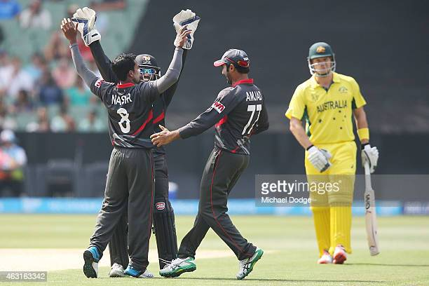Nasir Aziz OF UAE celebrates the wicket of Michael Clarke of Australia with keeper Swapnil Patil and Amjad Ali of UAE during the Cricket World Cup...