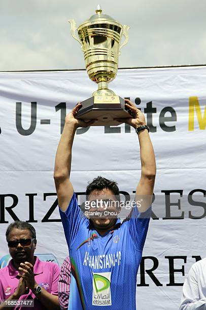 Nasir Jamal Ahmadzai captain of Afghanistan lifts the Elite Cup aloft after they defeated United Arab Emirates during the 2013 Asian Cricket Council...