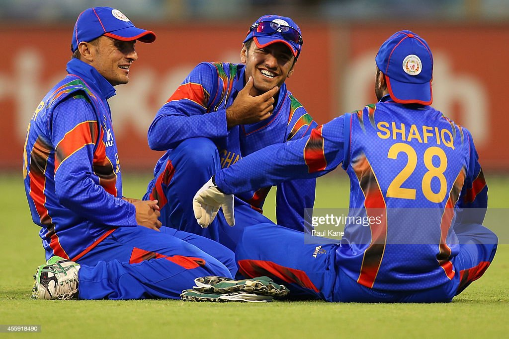 Nasir Jamal, Najibullah Zadran and Shafiqullah Shafaq of Afghanistan chat before the resumption of play during the One Day tour match between the Western Australia XI and Afghanistan at the WACA on September 22, 2014 in Perth, Australia.