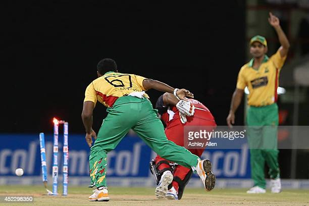 Nasir Jamshed is run out by Krishmar Santokie during a match between Guyana Amazon Warriors and The Trinidad Tobago Red Steel as part of the week 2...