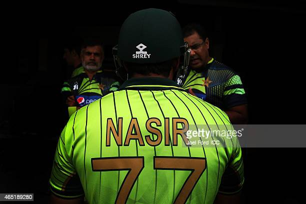 Nasir Jamshed of Pakistan speaks with coaches before heading out to bat during the 2015 ICC Cricket World Cup match between Pakistan and the United...