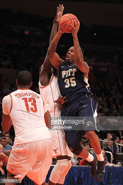 Nasir Robinson of the Pittsburgh Panthers shoots over the top of Alexis Wangmene of the Texas Longhorns during the Championship game of the 2k Sports...
