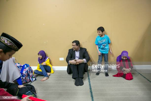 Nasir Zakaria plays with children at the Rohingya Cultural Center of Chicago on January 10 2019 in Chicago Illinois Chicago has one of the largest...