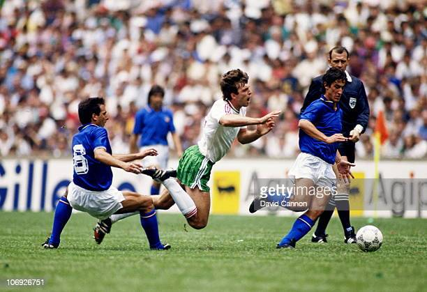 Nasko Sirakov of Bulgaria is fouled by Gaetano Scirea of Italy as Fernando de Napoli of Italy chases the ball during the 1986 FIFA World Cup Finals...