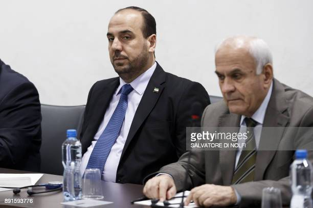 Nasr alHariri Head of the Syrian Negotiation Commission SNC and a member of the SNC attend a round of negotiations with the UN Special Envoy of the...