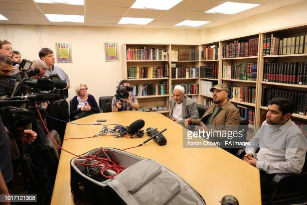 Nassar Mahmood of Birmingham Central Mosque and Ali Mohamed a representative of the local Sudanese community speak during a press conference at the...