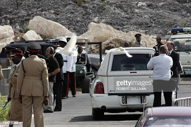 Doves fly as a hearse carries the coffin of Anna Nicole Smith to the cemetery leaving the Bahamas church 02 March 2007 as the former Playboy model...