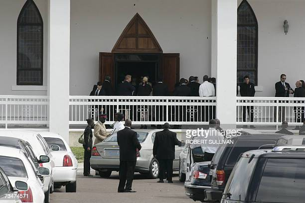 Mourners wait for Anna Nicole Smith's coffin to appear at at Bahamas church 02 March 2007 as the former Playboy model headed to her final resting...
