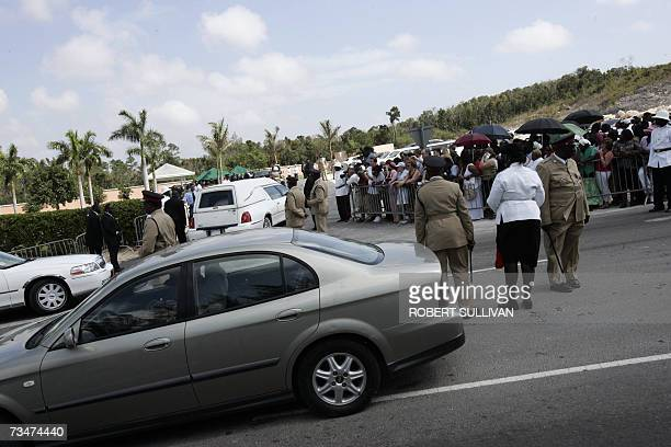 The casket containing the body of Anna Nicole Smith enters the cemetery 02 March 2007 in Nassau as the former Playboy model headed to her final...