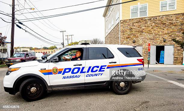 Nassau County Police officer sits in front of a crime scene at 130 Secatogue Ave October 29 2014 in Farmingdale New York According to reports police...