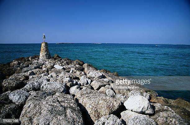 nassau jetty with beacon - cable beach bahamas stock photos and pictures