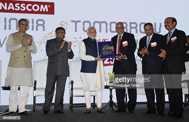 Nasscom Chairman R Chandrasekaran presents a monument to Prime Minister Narendra Modi with Nasscom president N Chandrasekhar Union Minister...