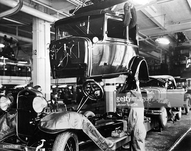 FORD ASSEMBLY LINE 1927 /nAssembly line production of the Model A at a Ford automobile plant in Detroit Michigan 1927