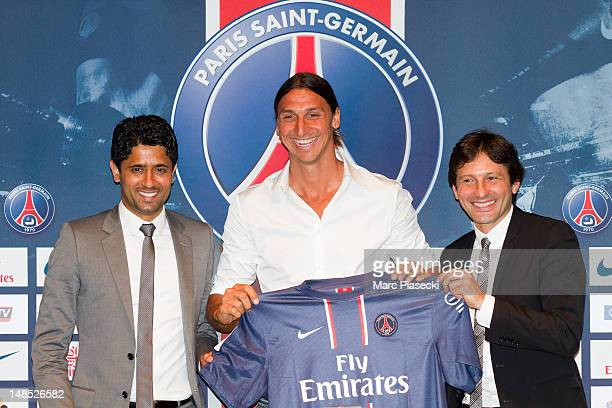 Nasser Al Khelaifi and Leonardo Nascimento de Araujo welcome Zlatan Ibrahimovic during the press conference for Paris Saint Germain at Parc des...