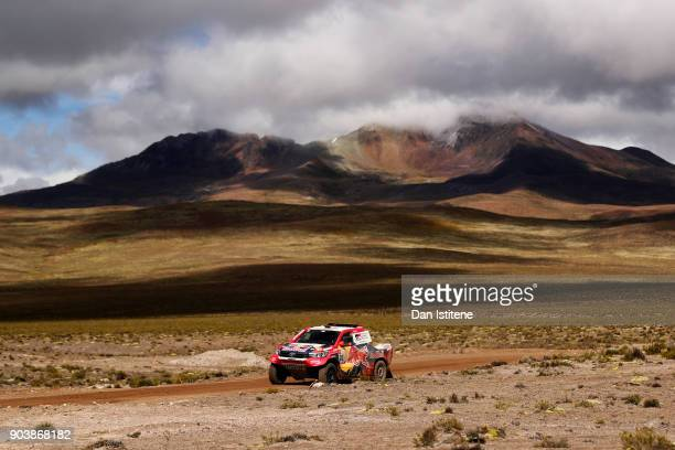 Nasser AlAttiyah of Qatar and Toyota Gazoo Racing drives with codriver Matthieu Baumel of France in the Hilux Toyota car in the Classe T11 4x4...