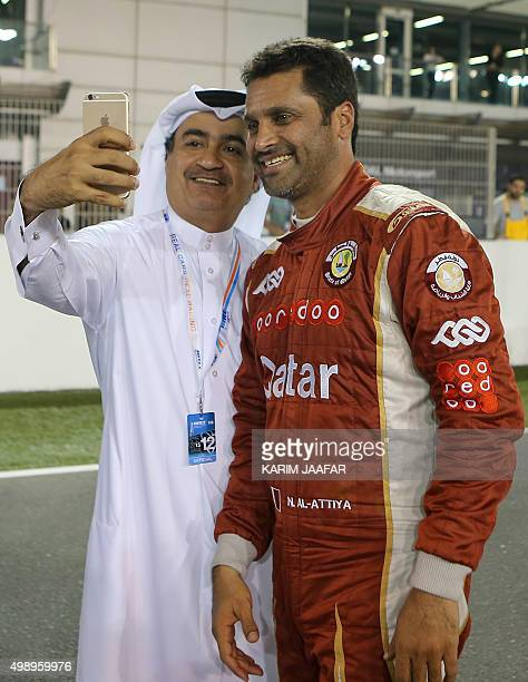 Nasser al-Attiyah of Qatar poses for a picture with a fan following the first night race during the 2015 FIA World Touring Car Championship at the...