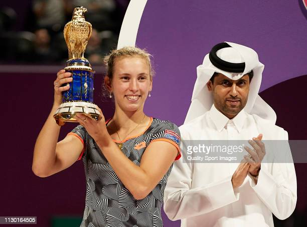 Nasser AlKhelaifi president of PSG and the Qatar Tennis Federation and Elise Mertens of Belgium celebrates with the trophy following the Women's...