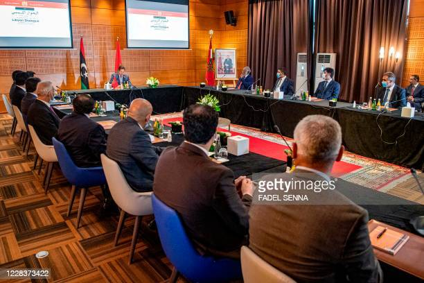 Nasser Bourita, Morocco's Minister of Foreign Affairs and International Cooperation, chairs a meeting of representatives of Libya's rival...
