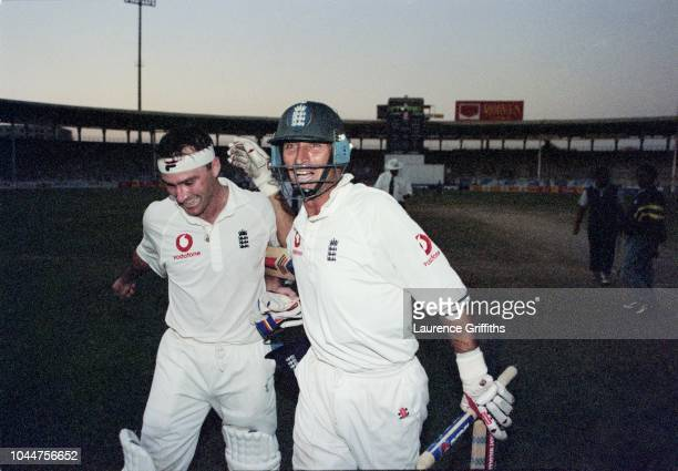 Nasser Hussain and Graham Thorpe of England celebrate a series win in the twilight dark during the 3rd Pakistan v England Test match on 11 December...