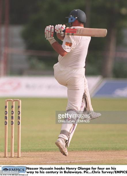Nasser Hussain hooks Henry Olonga for four on his way to his century at the Queens Club in Bulawayo.