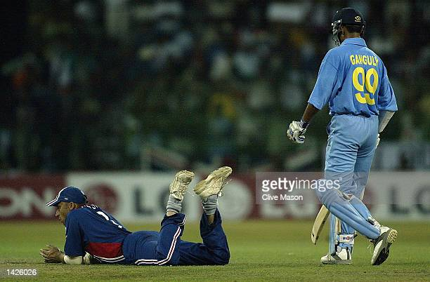 Nasser Hussain of England attempts to run out Saurav Ganguly of India to no avail during the ICC Champions Trophy match between England and India at...