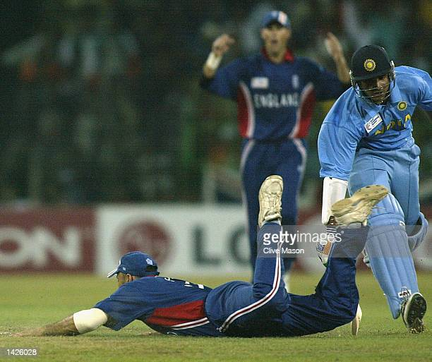 Nasser Hussain of England attempts to run out Saurav Ganguly of India during the ICC Champions Trophy match between England and India at the...