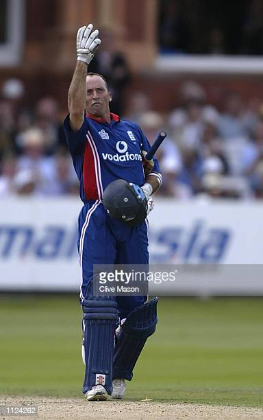 Nasser Hussain of England gestures to the press box after scoring his century during the match between England and India in the NatWest One Day...