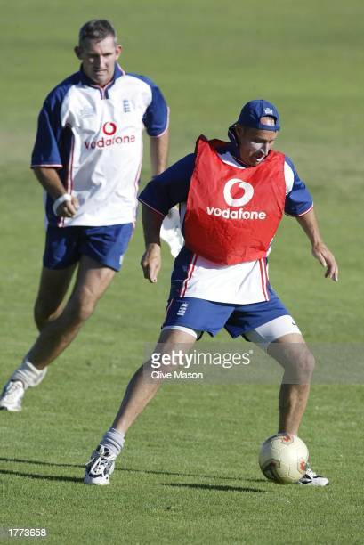 Nasser Hussain of England in possession during a game of football watched by Andrew Caddick during a practice session at the Belville cricket ground...