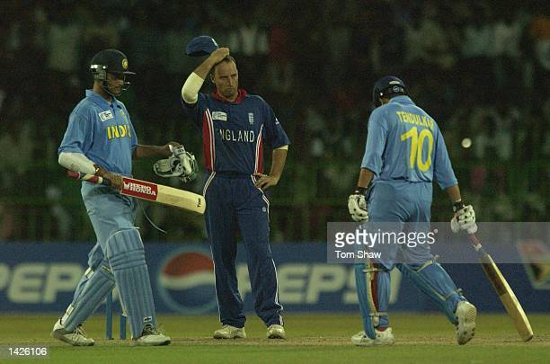Nasser Hussain of England looks dejected as Indian batsmen Sourav Ganguly and Sachin Tendulkar have a chat during the England v India match of the...