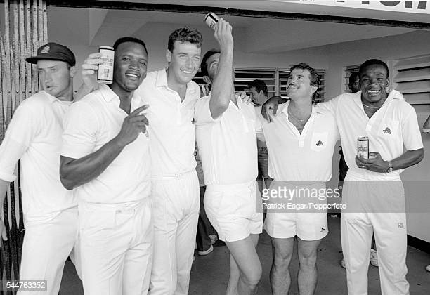 Nasser Hussain of England squeezes past the celebratory group of England players Devon Malcolm Angus Fraser Graham Gooch Allan Lamb and Gladstone...