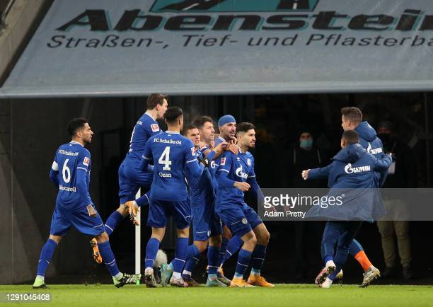 Nassim Boujellab celebrates his team's second goal with teammates during the Bundesliga match between FC Augsburg and FC Schalke 04 at WWK-Arena on...