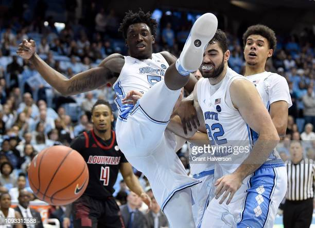 Nassir Little and Luke Maye of the North Carolina Tar Heels watch a rebound during the second half of their game against the Louisville Cardinals at...