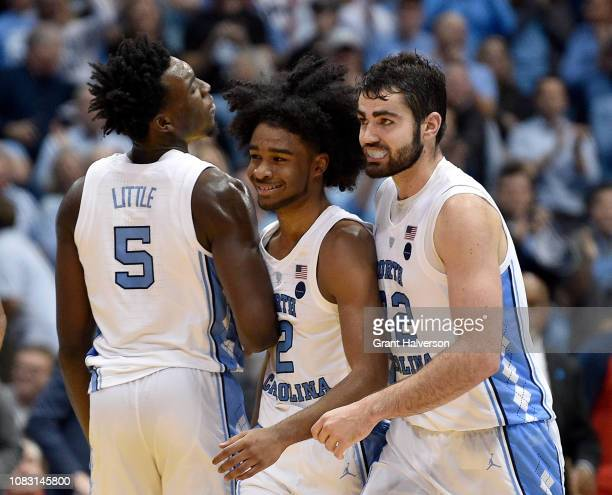 Nassir Little Coby White and Luke Maye of the North Carolina Tar Heels react during the second half of their against the Gonzaga Bulldogs game at the...