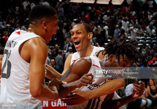 Nassir Little of Orlando Christian Prep is congratulated by teammates Keldon Johnson of Oak Hill Academy and Darius Bazley of Princeton High School...